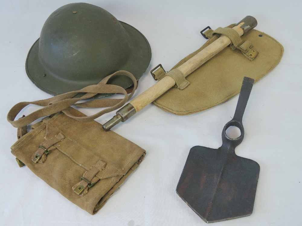 Lot 2 - A WWII British helmet, Bren pouch and entrenching tool.