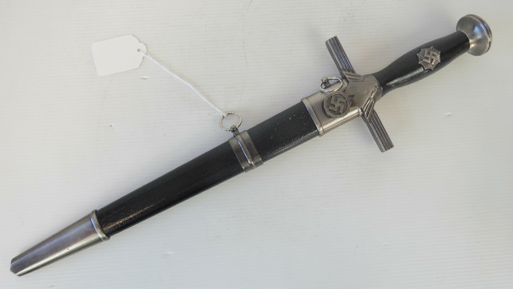 Lot 23 - A reproduction WWII German dagger complete with sheath, 28cm blade.