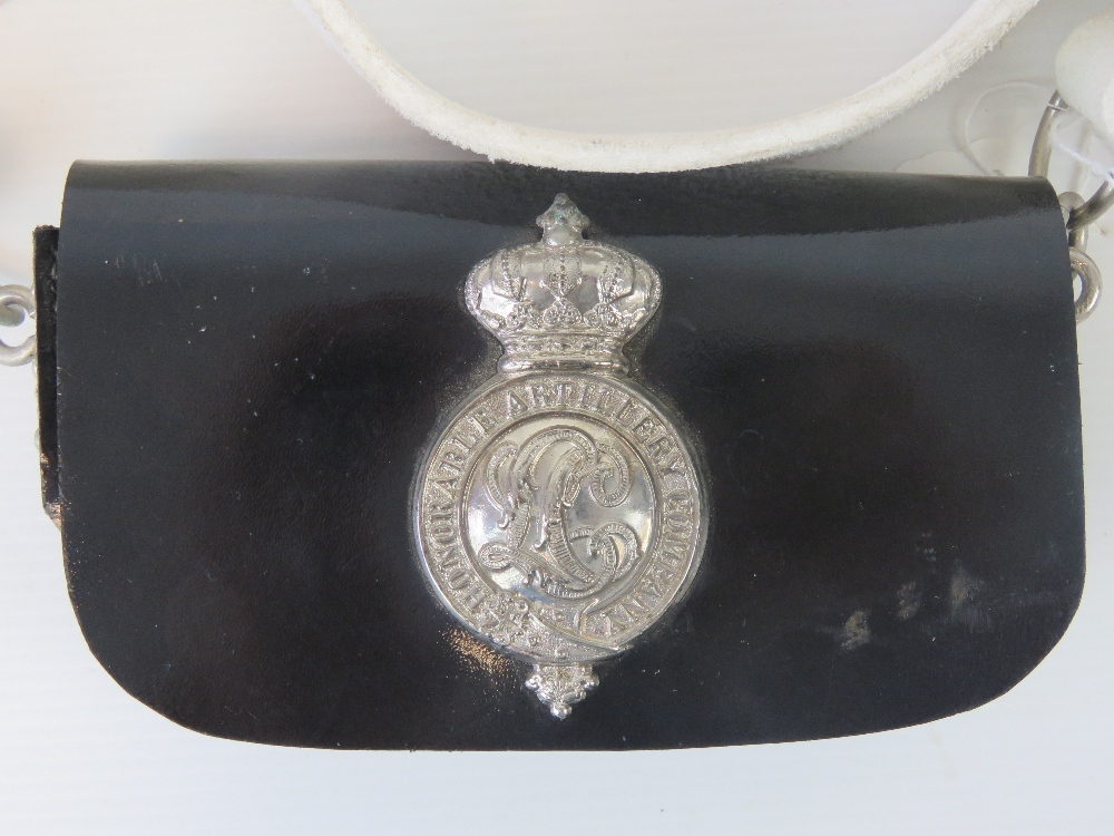 Lot 43 - A white leather cross belt complete with buckle and black pouch bearing Honourable Artillery