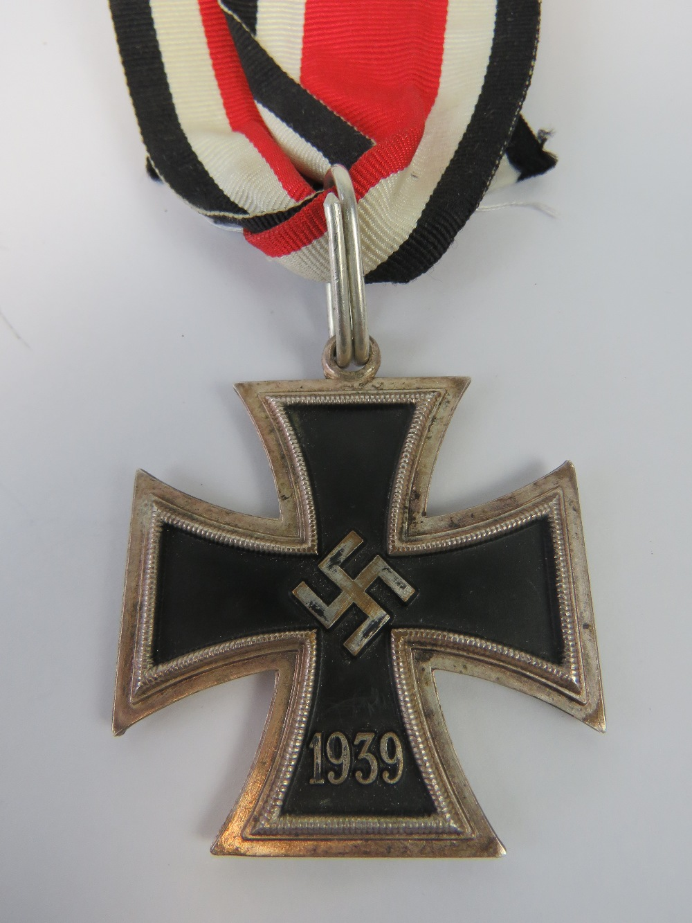 Lot 58 - A WWII German Knights Cross medal complete with ribbon.