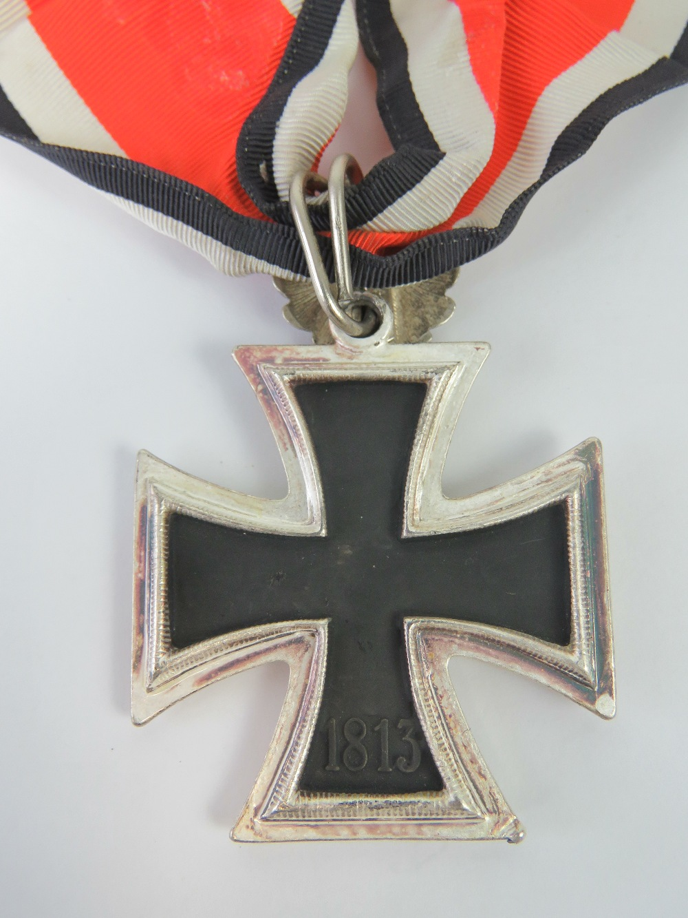 Lot 13 - A WWII German Knights Cross medal with Oak Leaves and ribbon.