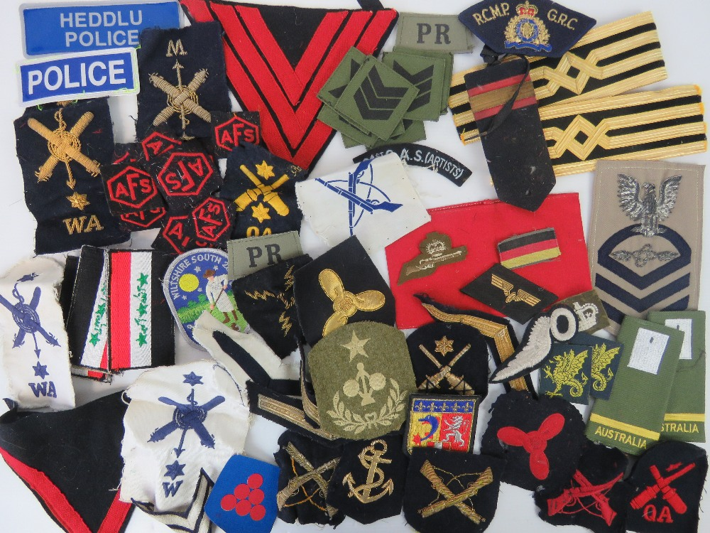 Lot 31 - A quantity of cloth military badges, various ages, including; Welsh Police, epaulettes, AFS,