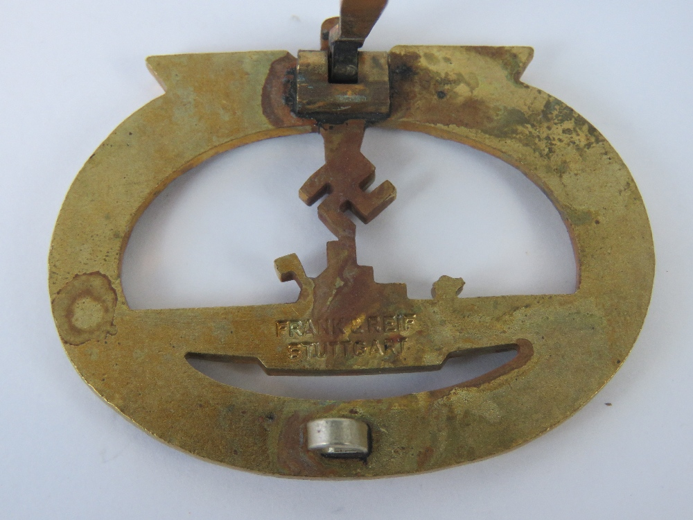 Lot 21 - A WWII German Kriegsmarine U Boat badge in gold colour, marked Frank & Reif Stuttgart.
