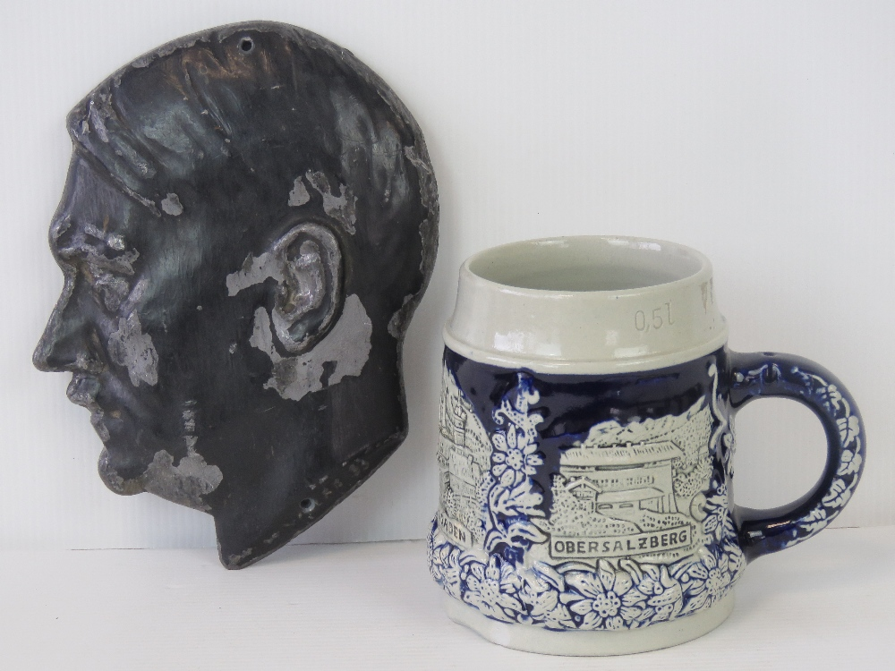 Lot 27 - A Berchtasgarden beer jug and a cast metal hitler profile plaque. Two items.