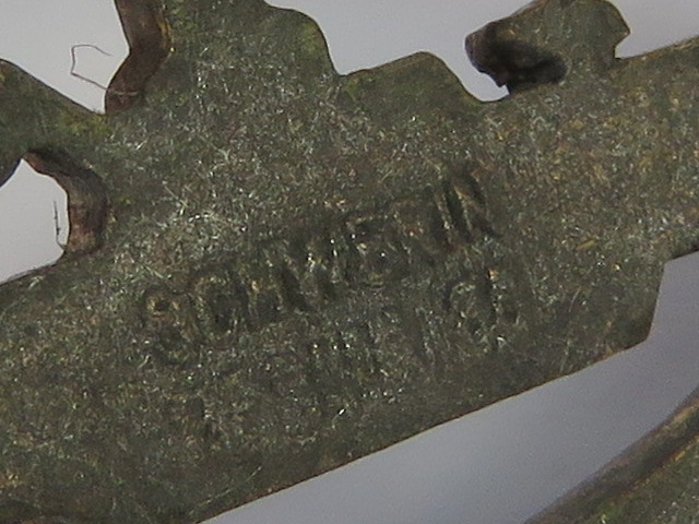 Lot 11 - A WWII German U-boat 'gold' badge marked 'Schwerin..?'.