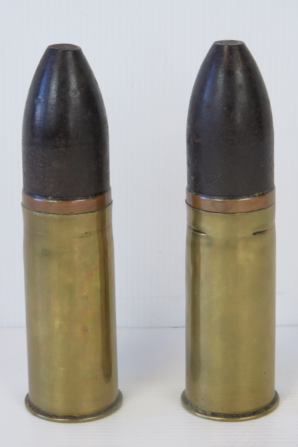 Lot 36 - Two WWI ordnance shells, one stamped June 1918 Sp255 119A and the other 1904 116, 16cm high.