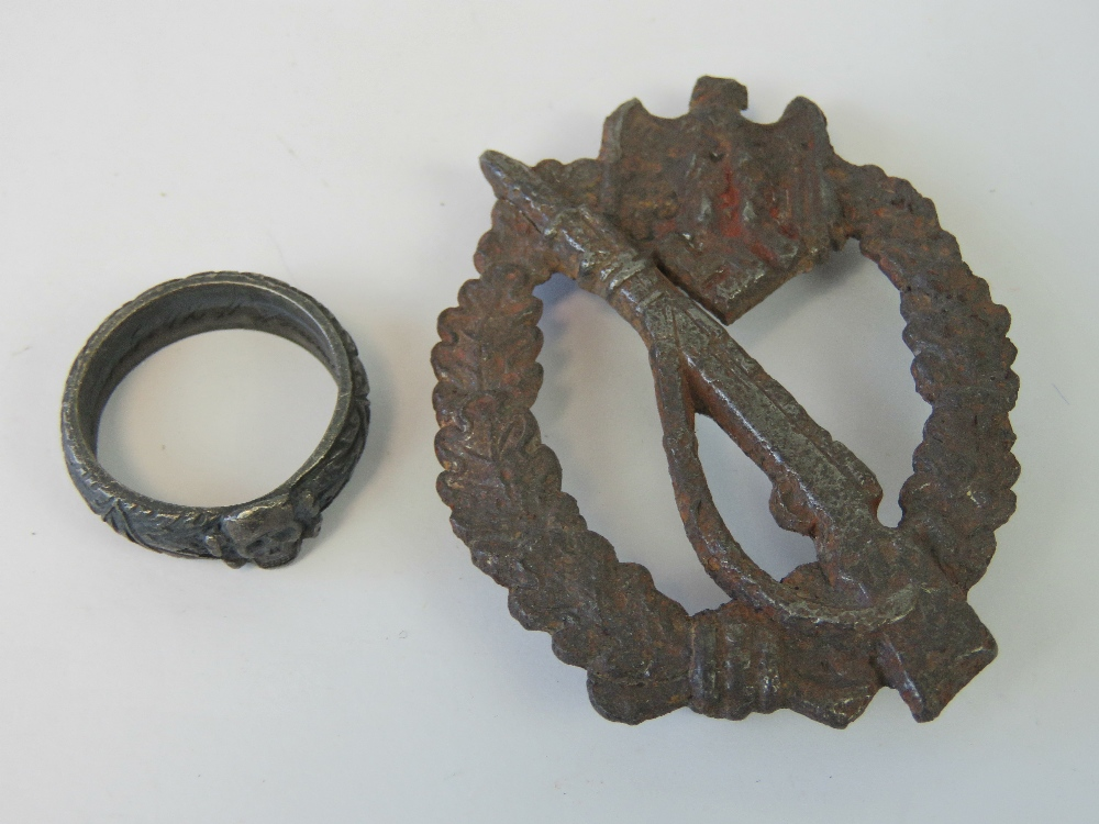 Lot 57 - A WWII German Infantry badge, in relic condition, together with a SS honour ring. Two items.