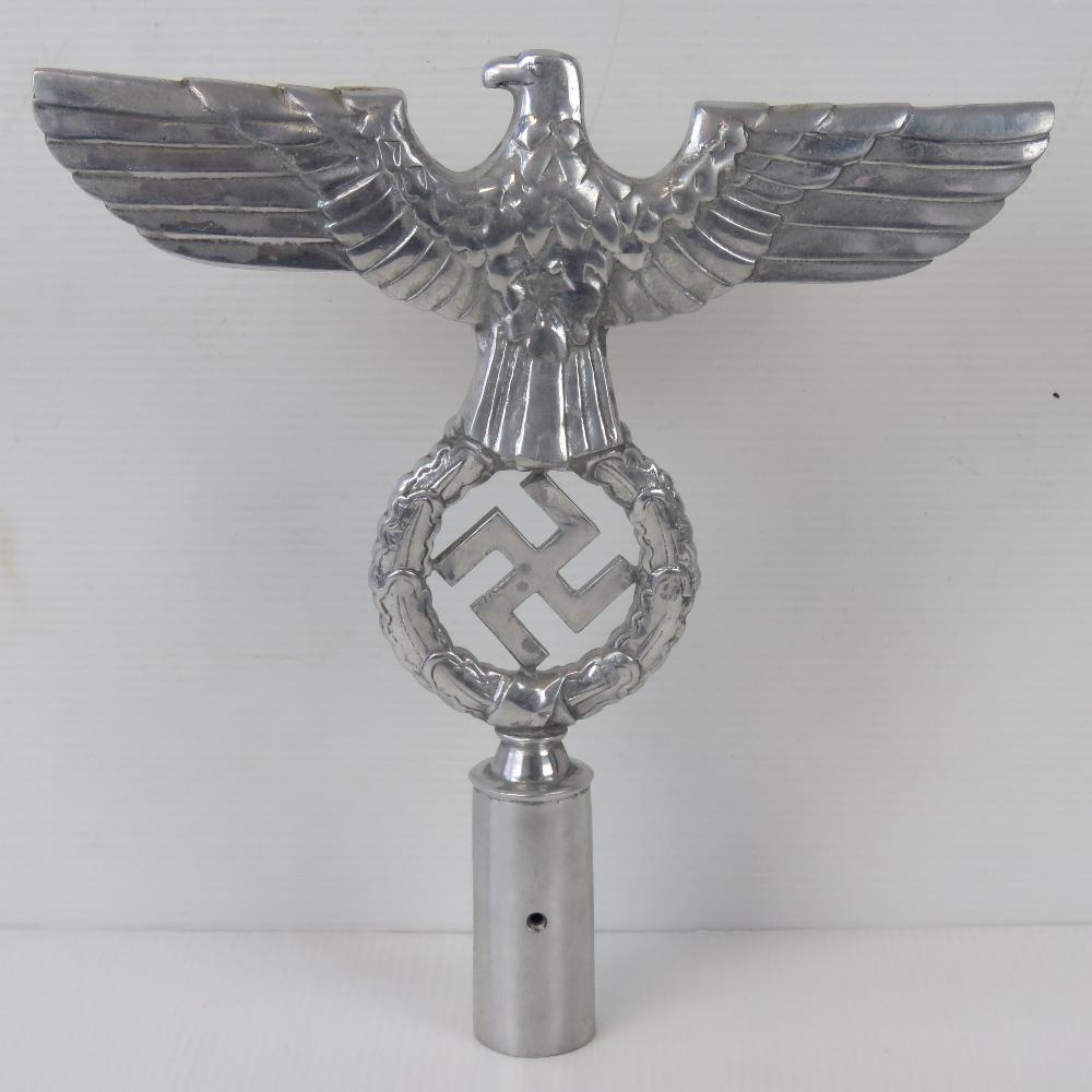 Lot 1 - A large cast aluminium eagle and swastika wreath flagpole finial for political leaders, 25cm high.