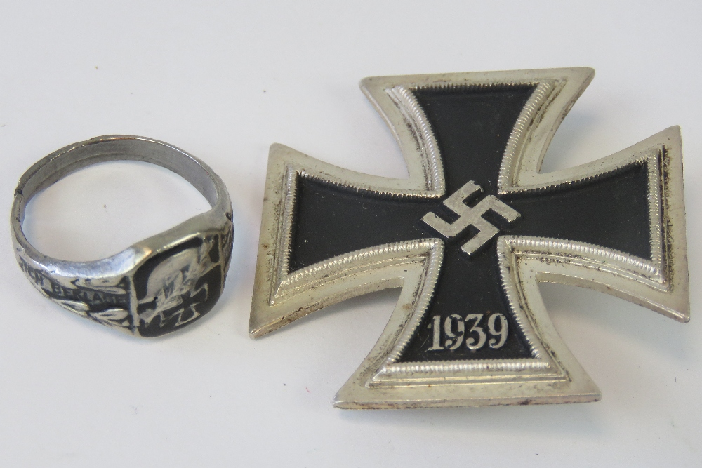Lot 14 - A WWII German Iron Cross 1st Class together with an Iron Cross ring (a/f cut band). Two items.