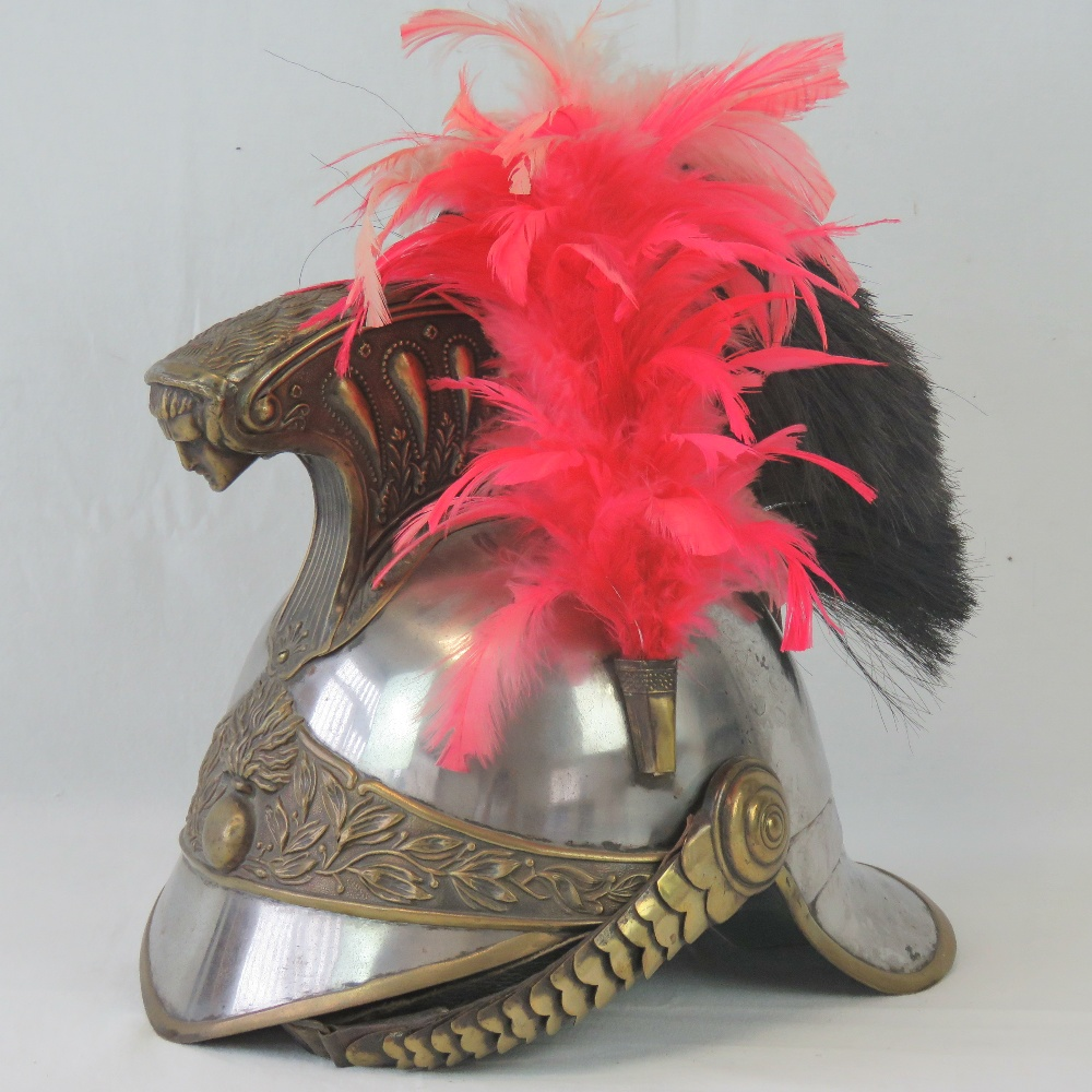 Lot 52 - A 19th century French cavalry helmet with elaborate detailing,