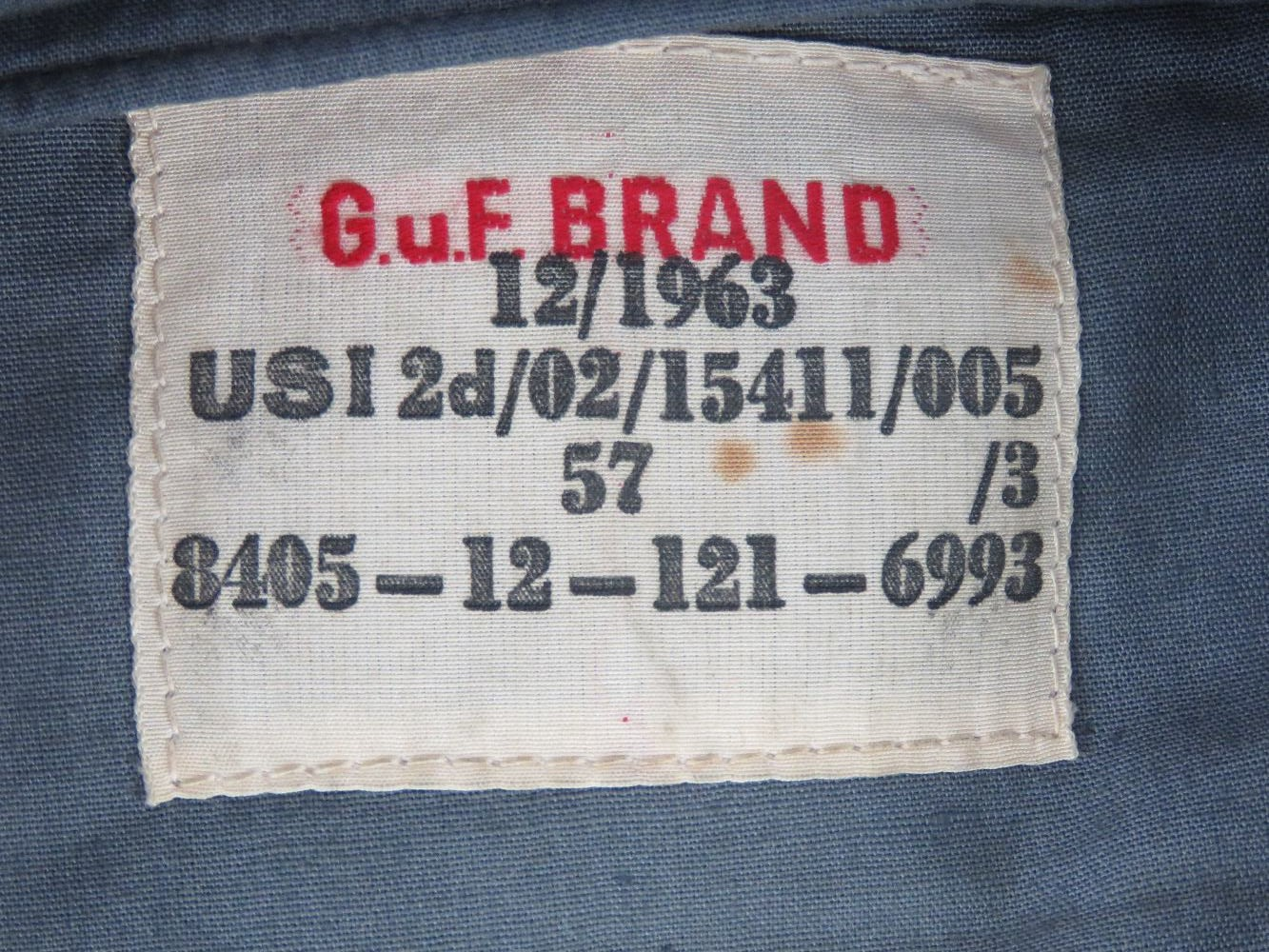 Lot 30 - An East German blue cloth side cap having label within dated 1963.