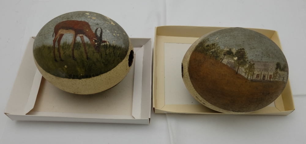 """Lot 55 - Pair of Ostrich Eggs, hand decorated with scenes – """"Market Square"""", deer, country landscapes –"""