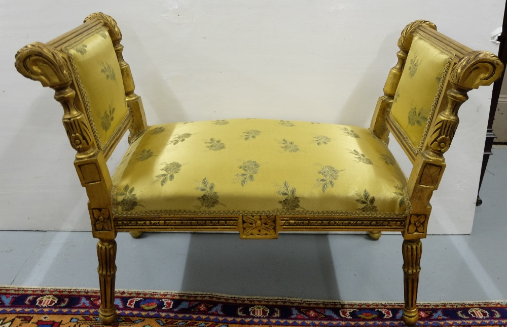 """Lot 23 - Carved gilt wood window seat, with gold padded fabric, on turned legs, 3ftw x 17"""""""