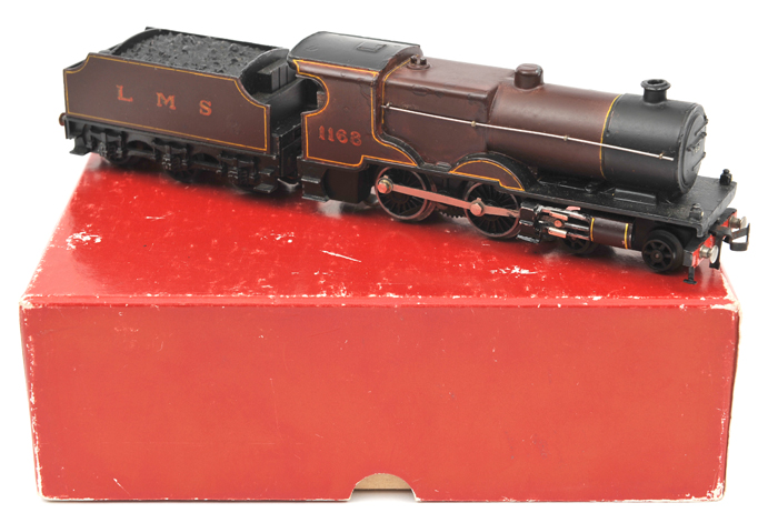 Lot 38 - TRIX OO gauge LMS 4-4-0 Compound locomotive and tender. RN 1168 in lined maroon livery. In