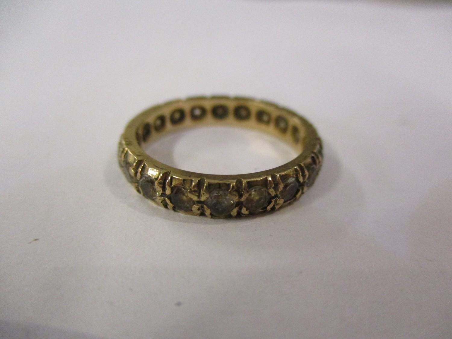 Lot 279 - A 9ct gold and sapphire set eternity ring Location: CAB