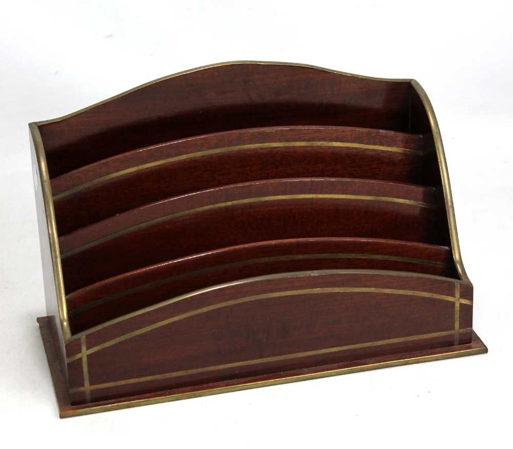 Lot 45 - An early 20th century mahogany and brass inlaid stationery rack, diameter 30cm.