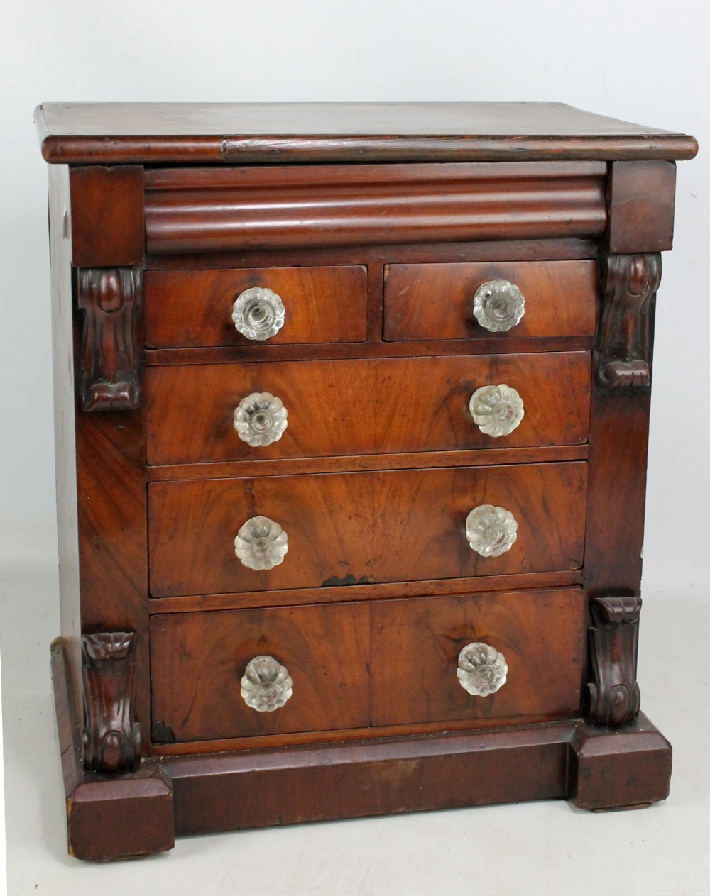 Lot 37A - A Victorian mahogany miniature chest of drawers, the moulded rectangular top above frieze, two short
