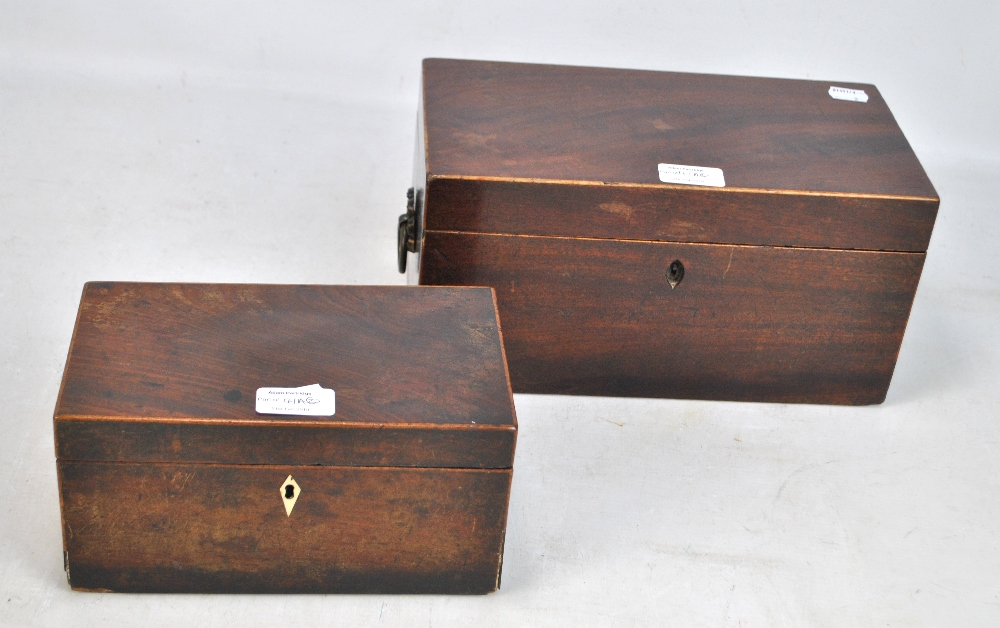 Lot 41A - A Regency mahogany and line inlaid twin handled tea caddy, with fitted interior (lacking bowl),