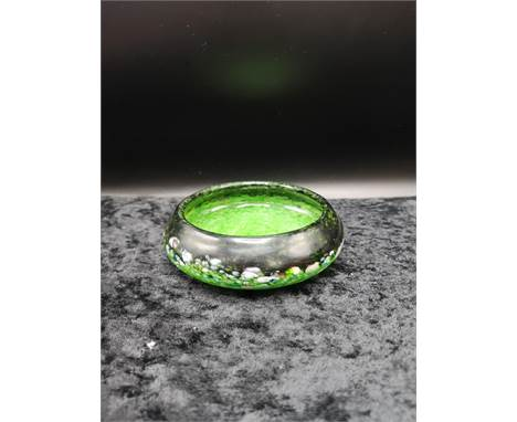 Scottish glass Monart bowl set in green and black with multiple colours.