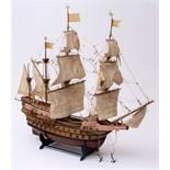 Modell eines Kriegsschiffes des 17.Jhdts.Mit drei Kanonendecks. Holz, Stoffbesegelung. L.83cm.