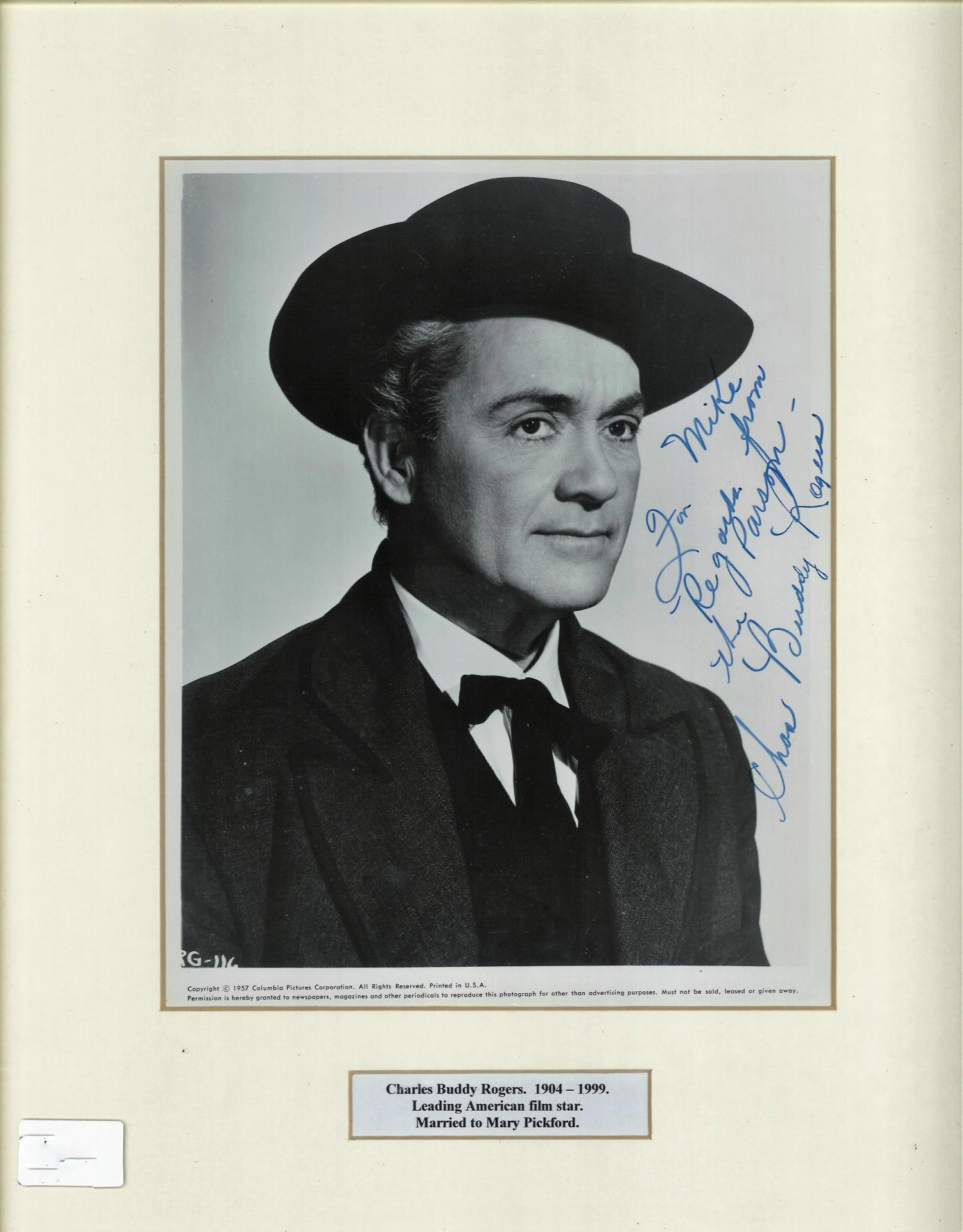 Lot 128 - Charles Buddy Rogers signed b/w photo. Mounted and framed to approx 16x12. Dedicated. Good