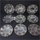 A set of 9 continental white metal coasters, 14oz