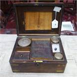 A 19th century campaign rosewood writing box, brass bound, H.13 W.28 D.20cm