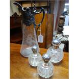 A pair of Victorian glass scent bottles with silver tops, together with a larger example by Mappin &