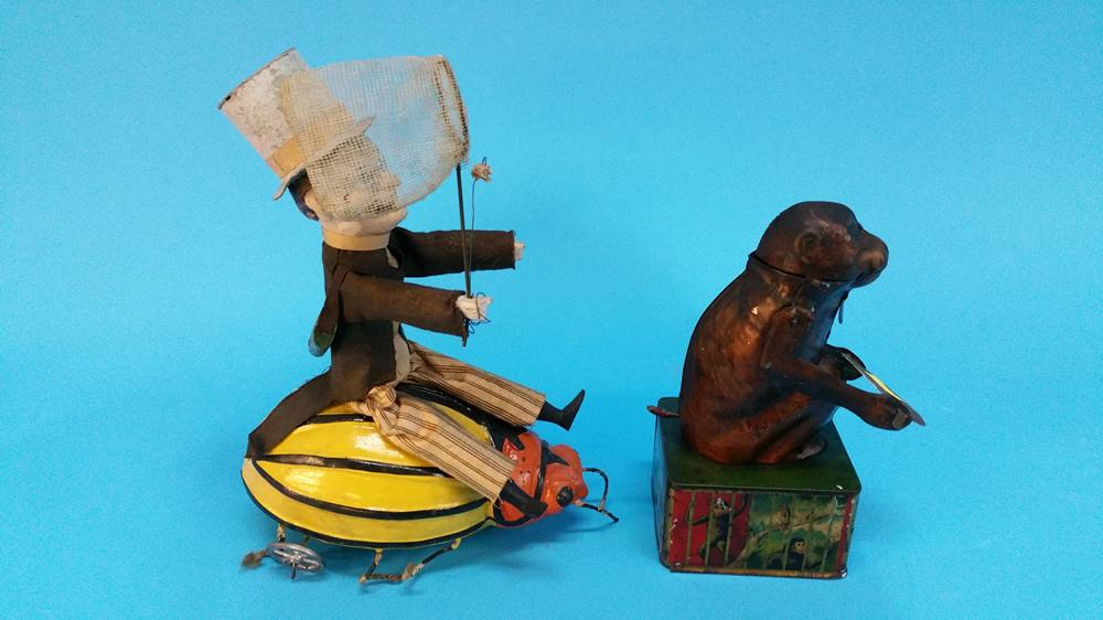 Lot 51 - A modern tin plate automaton and another with a ma