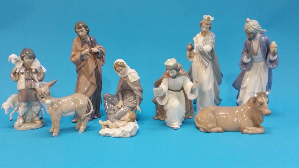 Lot 41 - A nine piece Nao Nativity scene.