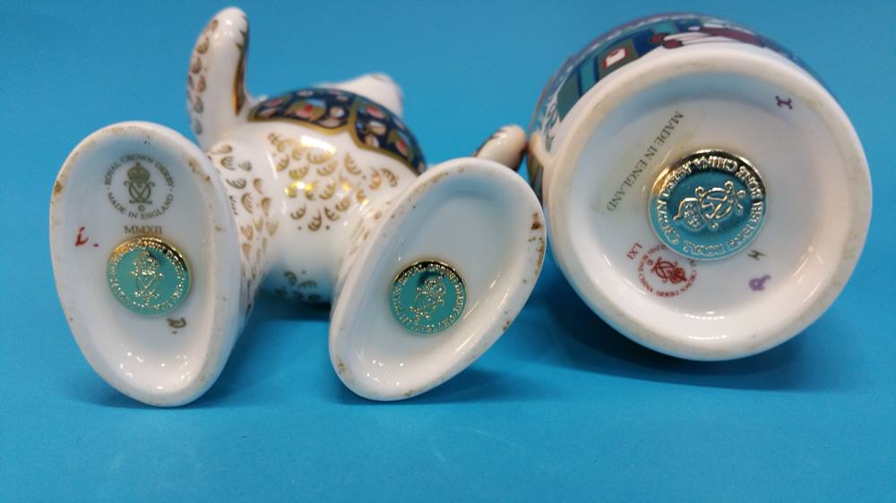 Lot 7 - Four Royal Crown Derby paperweights of reindeer, s