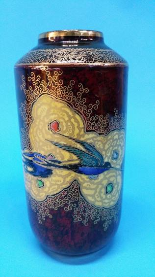 Lot 48 - A Carlton Ware vase on red ground, decorated with