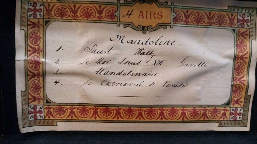 Lot 60 - A small travelling musical box playing four airs.