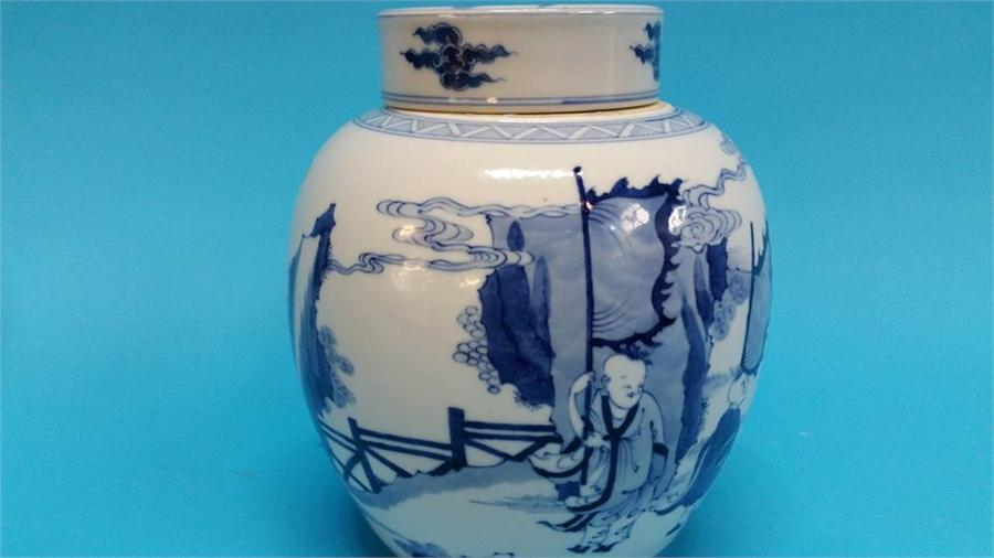 Lot 40 - A Chinese blue and white vase, decorated with bird