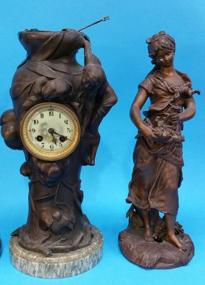 Lot 13 - A Spelter clock group, a Spelter figural table lam