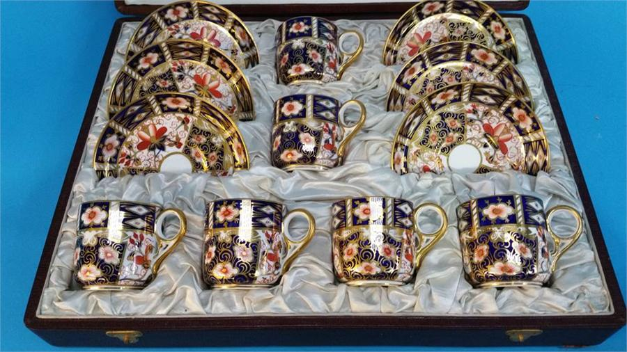Lot 24 - A cased set of six Royal Crown Derby coffee cans a