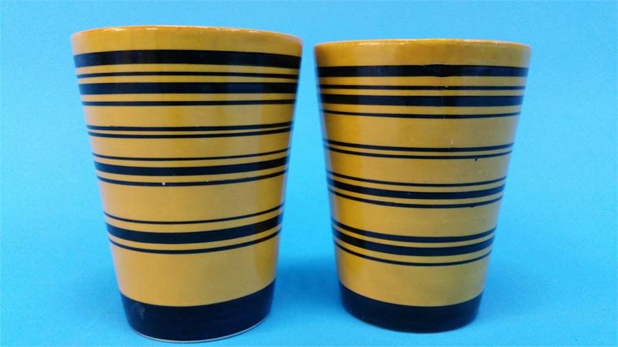 Lot 46 - A Clarice Cliff 'Gay Day' shallow bowl, a pair of