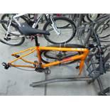 Orange Pinnacle cycle frame with 2 wheels