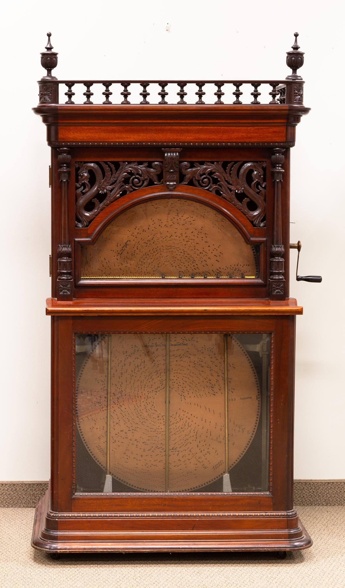 """Lot 220 - Fine Regina 27"""" Changer . Carved mahogany case with dragons. Original finish and in working order."""