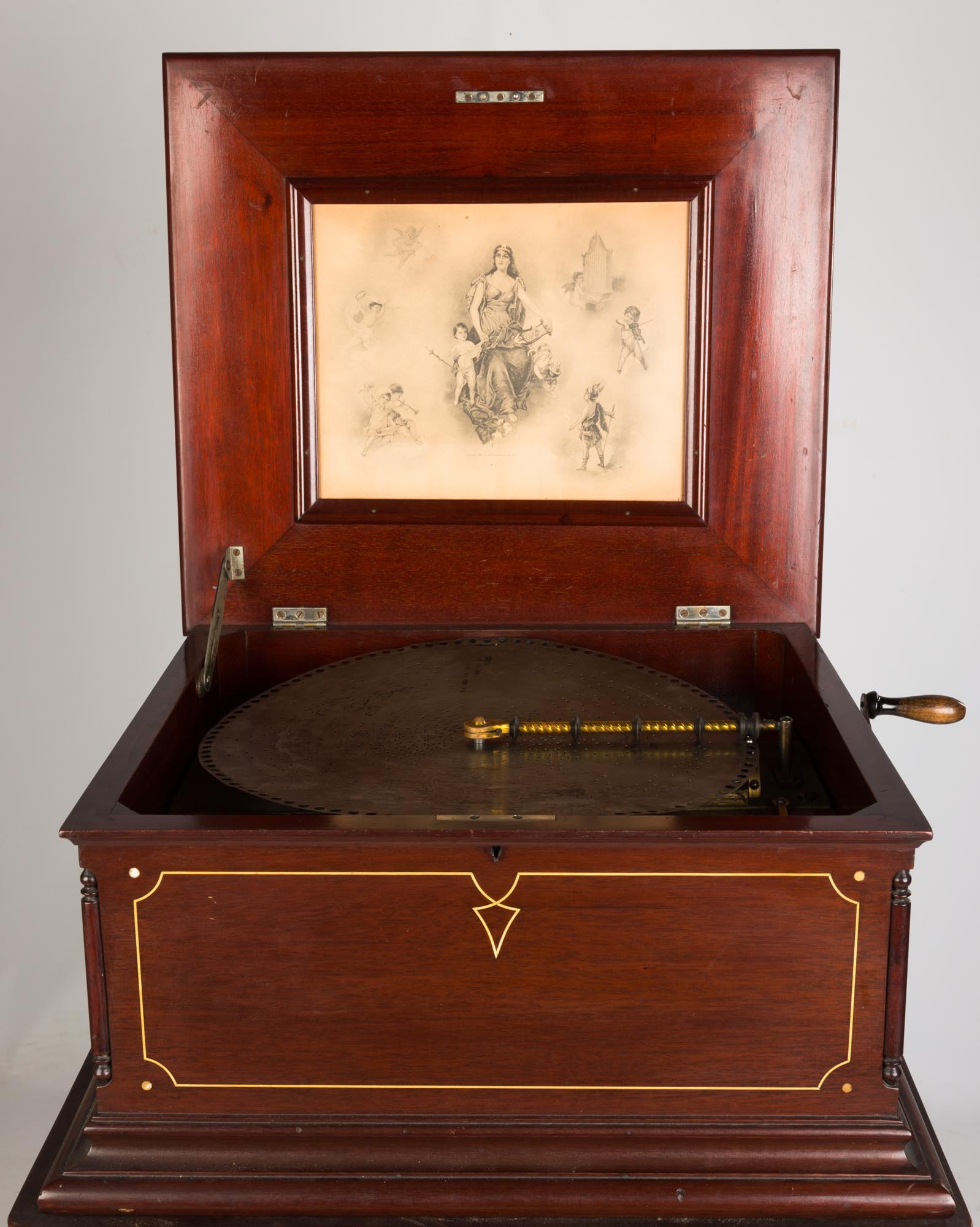 "Lot 217 - Regina Double Comb Disc Music Box & Stand. circa 1900. (33) 15 1/2"" disks. Inlaid mahogany case."