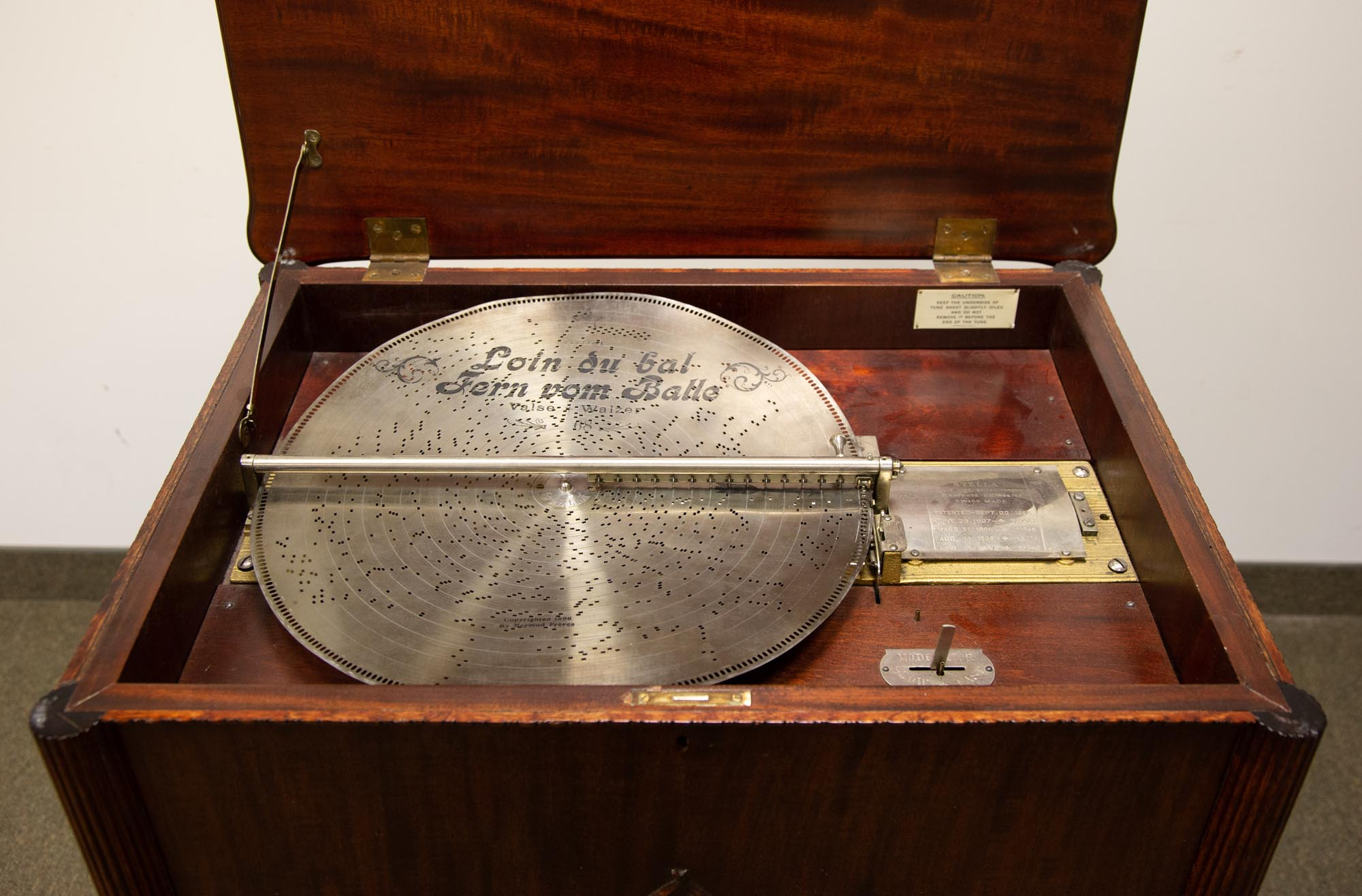 "Lot 219 - Stella Floor Model 17 1/4"" Disc Music Box. Ht. 37 1/2"" W 30"" D 22 1/2. Online bidding available:"