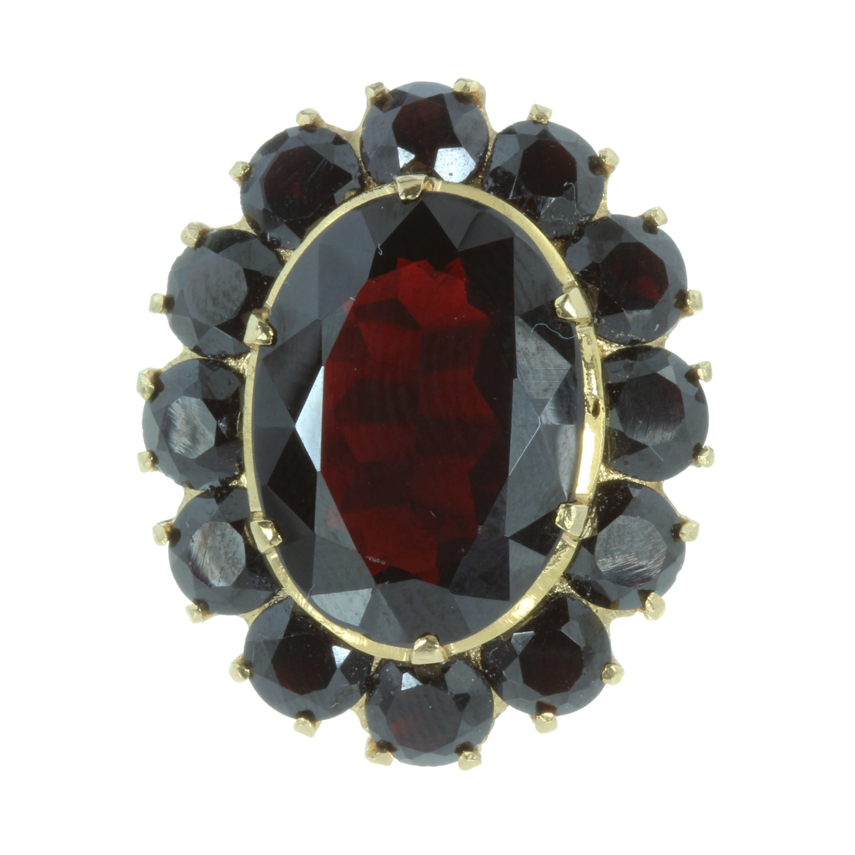 Los 39 - A GARNET CLUSTER COCKTAIL RING set with a large oval cut garnet surrounded by a cluster of twelve