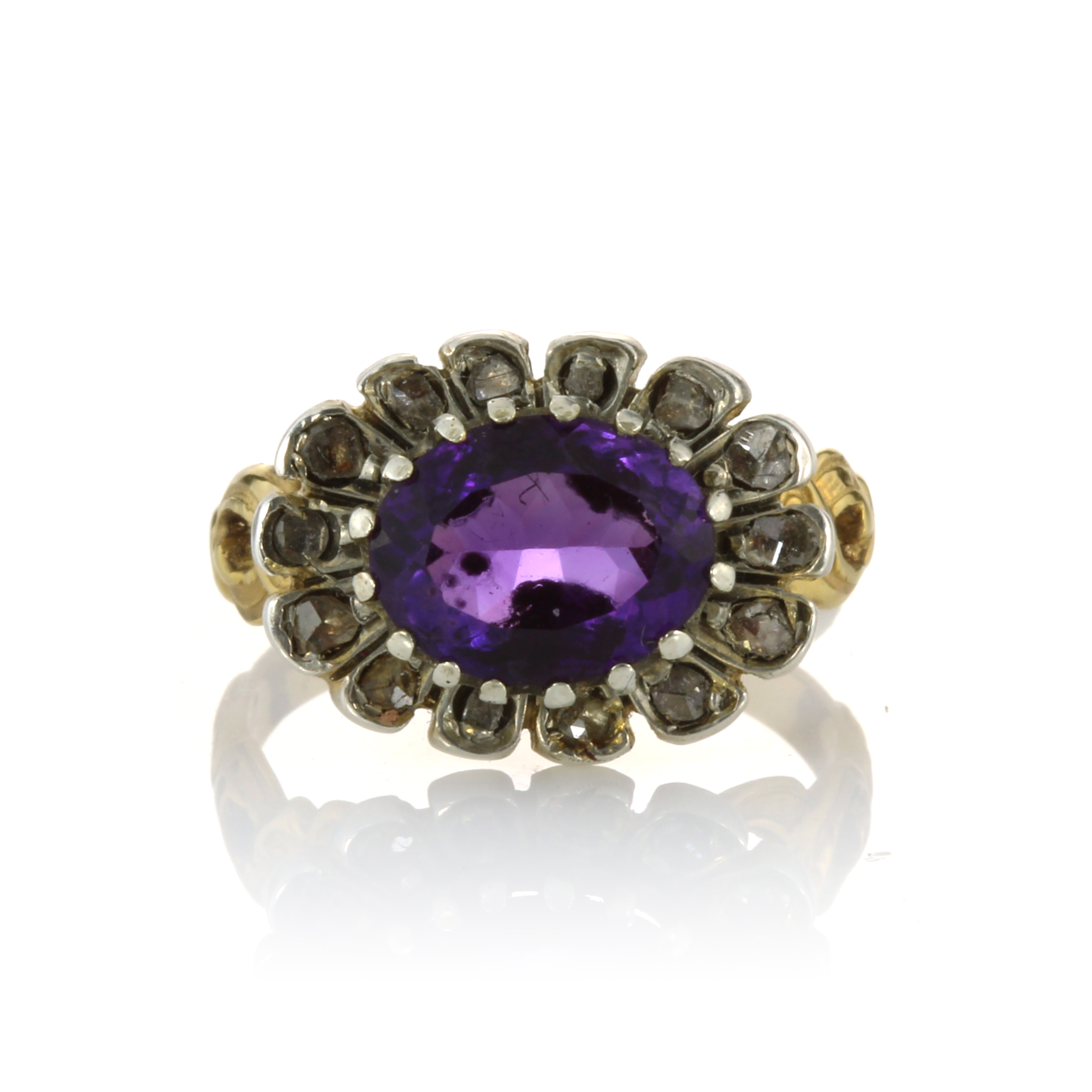 Los 30 - AN ANTIQUE AMETHYST AND DIAMOND DRESS RING, 19TH CENTURY set with an oval cut amethyst surrounded by