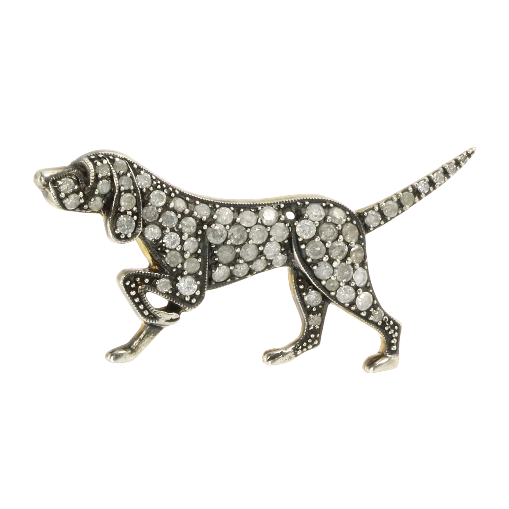 Los 52 - A DIAMOND DOG BROOCH modeled as a dog, walking with its tail and paw raised, jewelled all over the
