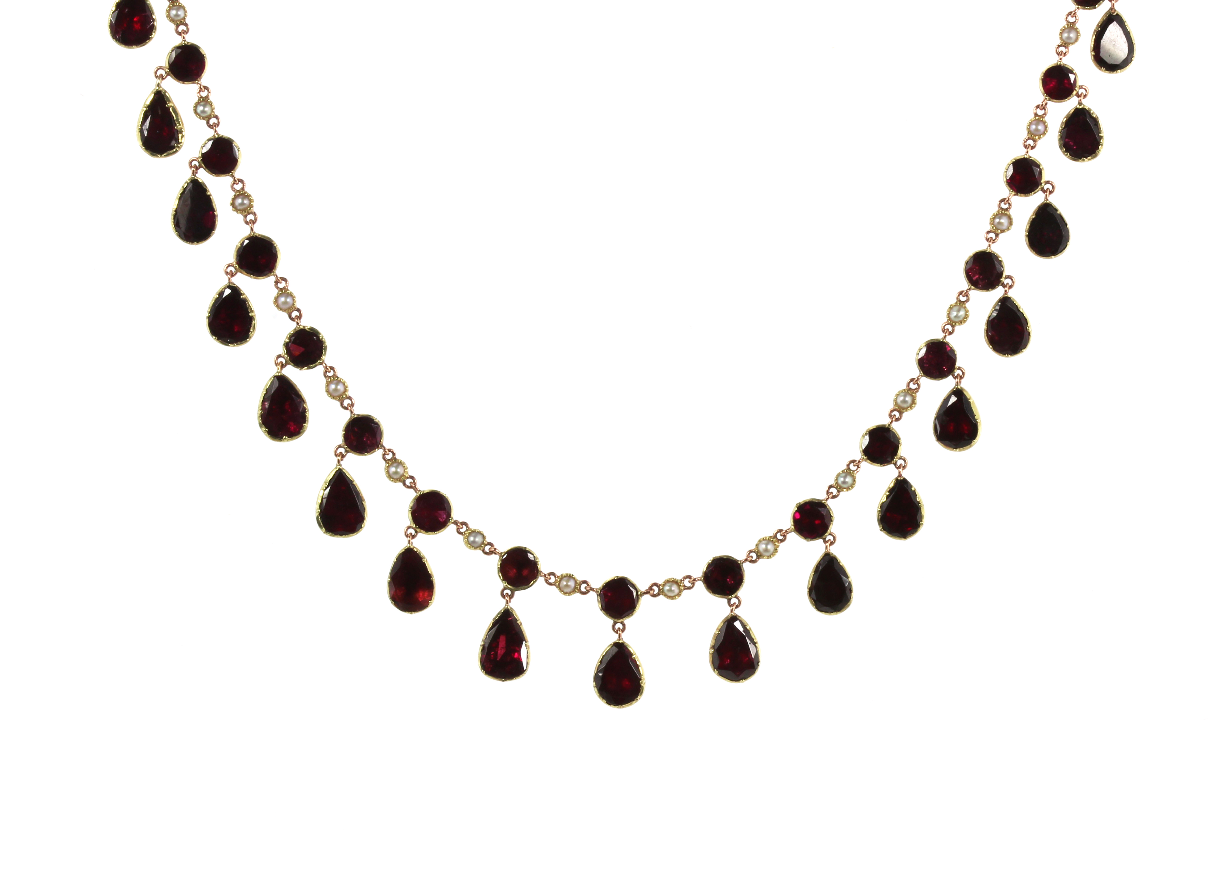 Los 36 - AN GARNET RIVIERA NECKLACE, 19TH CENTURY comprising a single row of alternating flat, round cut
