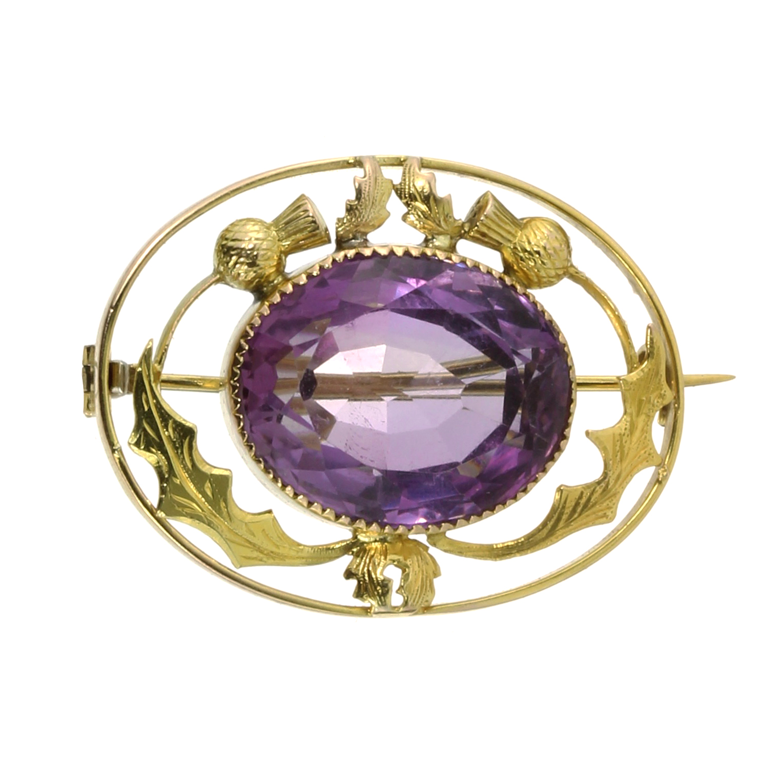 Los 33 - AN ANTIQUE SCOTTISH AMETHYST THISTLE BROOCH set with a large oval cut amethyst of 15.35 carats