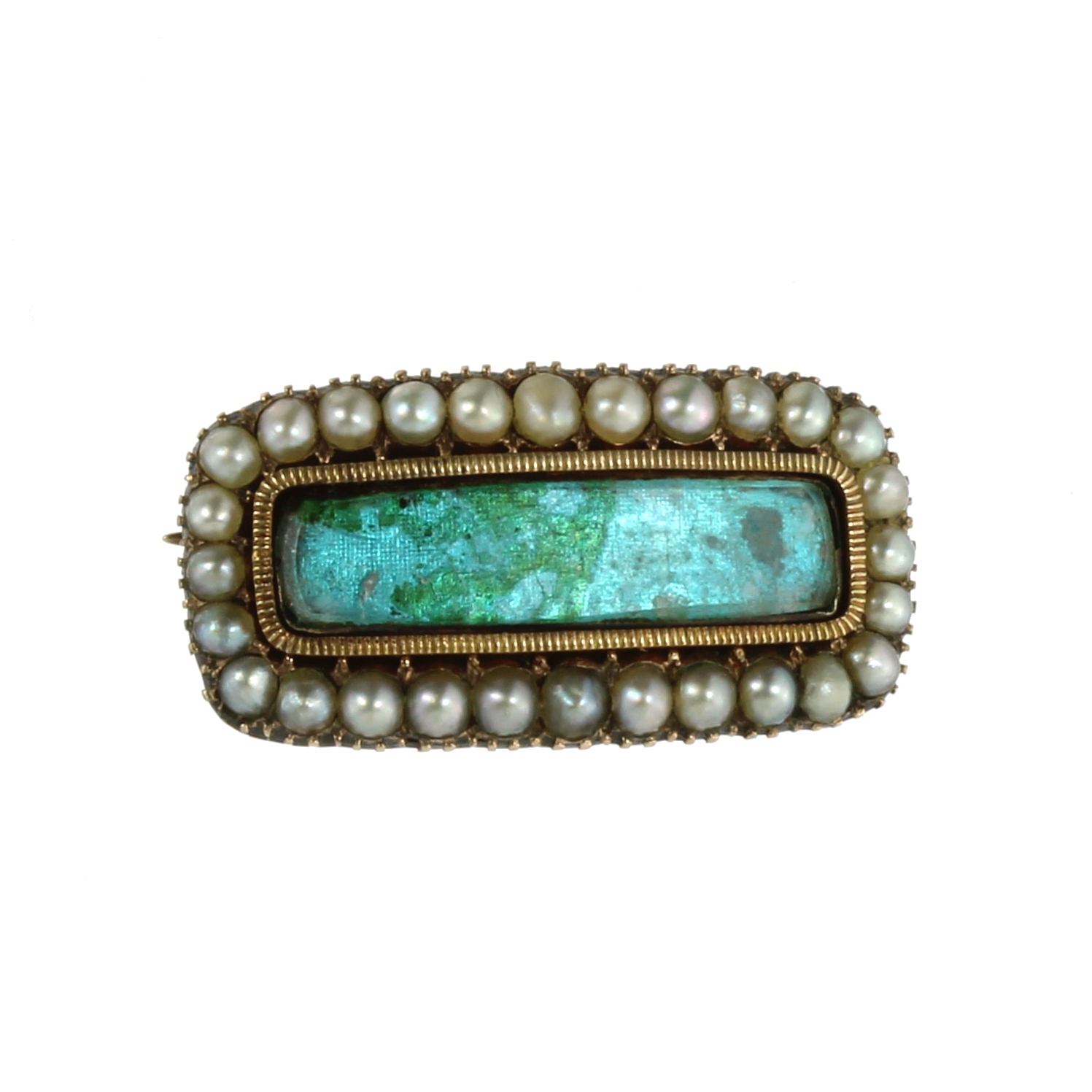 Los 25 - AN ANTIQUE SEED PEARL MOURNING BROOCH, 19TH CENTURY of rounded rectangular form with glass covered