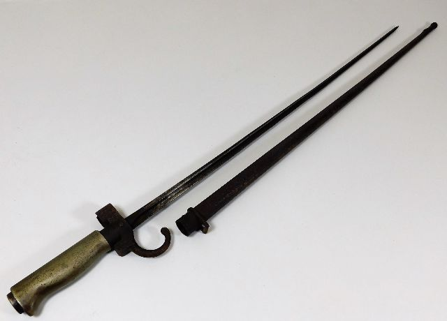 Lot 10 - A 19thC. French quatrefoil bayonet with scabbard