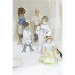 Lladro figure of a little girl holding two puppies,