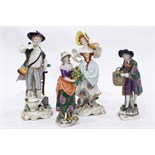 Pair of Sitzendorf male and female figures of labourers,